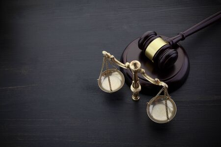 Judges Gavel And Scale Of Justice On The Black Table Background. Law Concept. Stockfoto - 128184801
