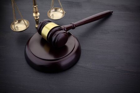 Judges Gavel And Scale Of Justice On The Black Table Background. Law Concept. Stockfoto - 128184796