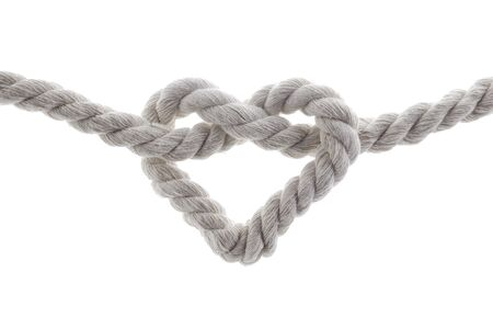 heart shape knot of rope isolated on white background Фото со стока