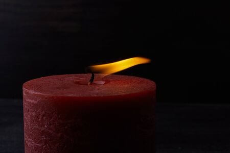 One Candle light on dark background. Hope concept