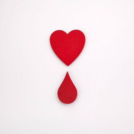 Giving blood saves live. Blood Donation concept. Red heart and blood drop on white background