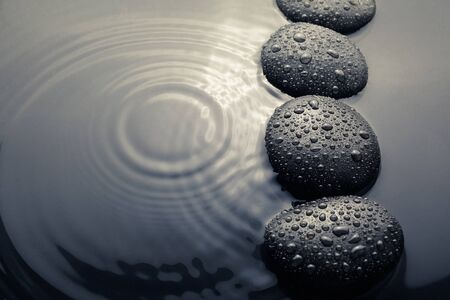 shiny zen stones with water drops. Top view