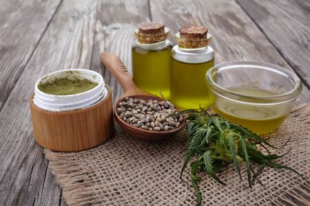 hemp oil, powder, seeds on wooden table
