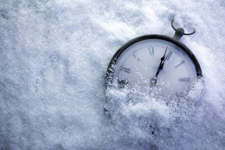 Christmas Time Clock under white snow, countdown to midnight