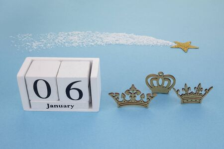 Epiphany Day Concept. 6 January calendar with tree kings crown on blue background