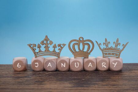 Epiphany, symbolized by tinkered crowns wooden background, Three Kings Day