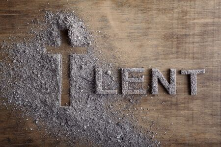 Lent word written in ash, dust as fast and abstinence period concept. Top view Stock Photo