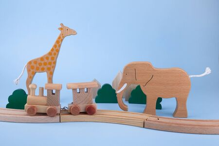 Wooden toys for children on blue background. Toys Background