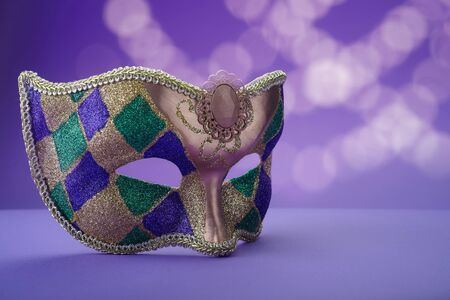 Traditional carnival mardi gras mask on table .Masquerade mask on glitter background. Mardi Gras