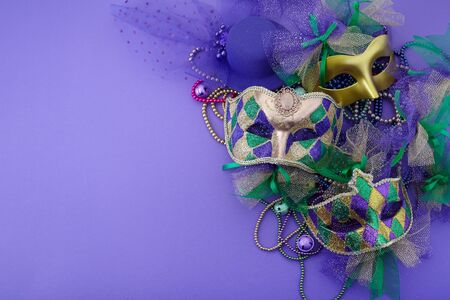 Mardi gras, venetian or carnivale mask on a purple background with copy space for text. Top view