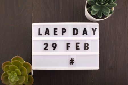 Date of the Leap Day. Calendar on wooden background Stock Photo