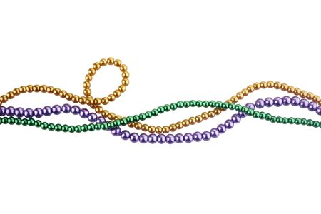 Three colors mardi gras beads for decoration isolated ob white background Foto de archivo