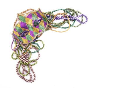 holiday or mardi gras beads and mask making frame isolated on white background Stock Photo