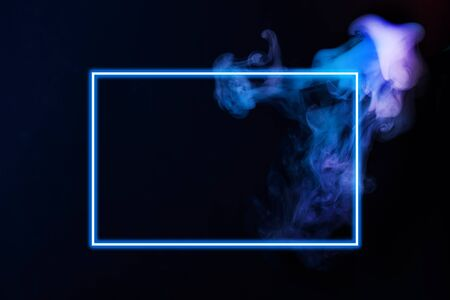 Abstract neon light smoke effect with neon frame on black background. Smoke cloud explosion. Mystic smoke. Фото со стока