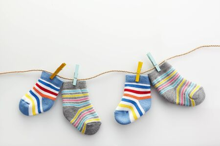 World Down syndrome day background. Down syndrome awareness concept. Socks and ribbon on white background