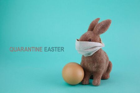 Quarantine easter. Coronavirus epidemic background. Global pandemic. Spring season. Easter egg. Stock Photo