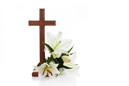 Cross with lilies isolated on white background for decorative design. Spring background. Easter card.