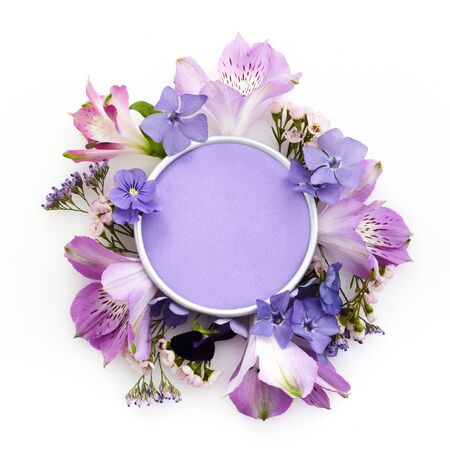 Frame made with various colorful flowers on white background with copyspace for text. Tlat lay. Top view