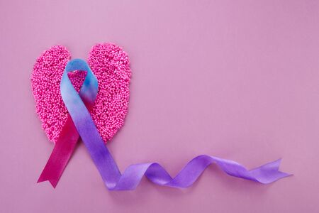 World Thyroid day background. Teal, pink and blue ribbon Stock Photo