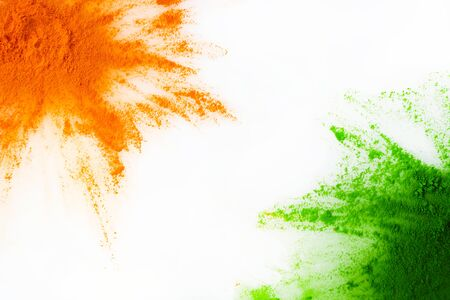 Orange and green color powder splash. Concept for India independence day, 15th of august. Standard-Bild