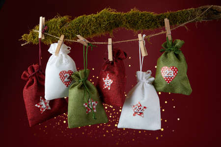 Advent calendar with surprise for Christmas on red background
