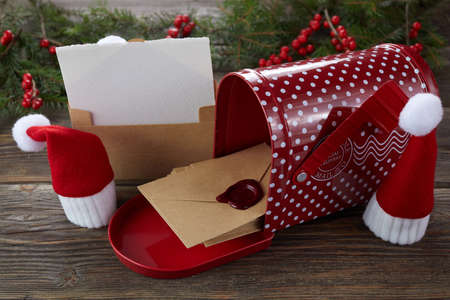 Empty wishlist for Santa Claus on wooden table with Christmas decorations. Top view.