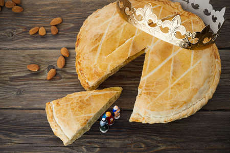Epiphany cake, French Galette de rois with figure of three kings.