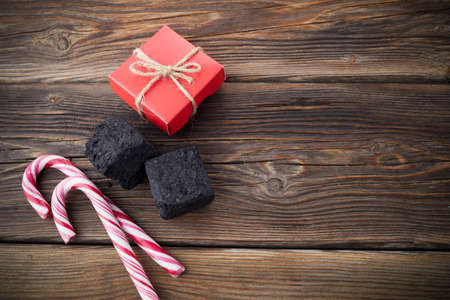 Christmas coal for bad kids and candys or gifts for good children. Christmas tradition in many countries.
