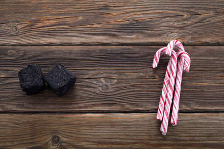 Christmas coal for bad kids ant candys or gift for good children. Christmas tradition in many countries.