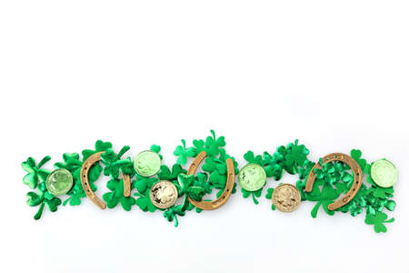 St Patricks Day border of shamrocks, gold coins isolated on white background