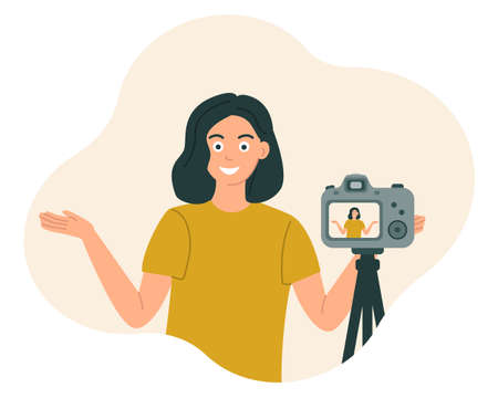 The blogger girl smiles and gestures in front of the camera, recording the video, photo. Vector illustration in flat style.