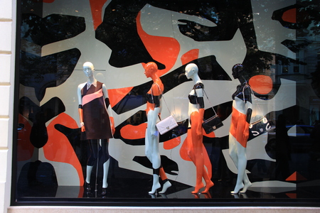fashion art: Four mannequins in a modern colorful store window inspired by pop art