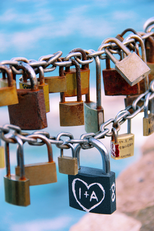 symbolize: Padlocks on a chain which symbolize eternal love Stock Photo