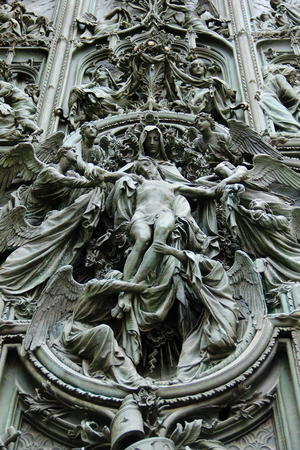 main gate: Details on the gate of the cathedral Duomo in Milan, Italy