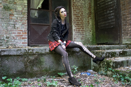 Punk rock girl in red plaid skirt