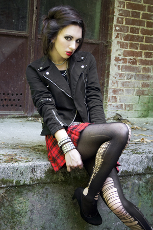 scottish female: Sexy edgy girl in ripped leggings and red plaid skirt