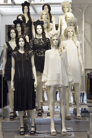 Store mannequins dressed in black and white boho dresses