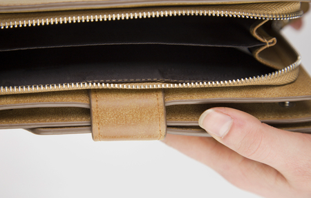woman holding wallet isolated