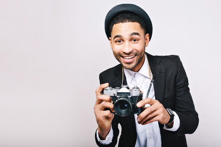 Portrait joyful successful guy in suit, hat having fun with camera on white background. Happy tourist, photographer, stylish look, travelling, smiling, excited, isolated. Place for text