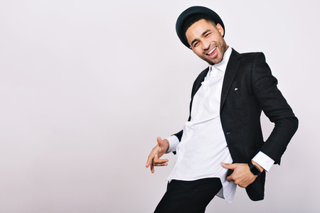 Stylish smiled guy in suit, hat having fun on white background. Leisure, cheerful mood, joy, happiness, dancer, modern businessman, isolated. Place for text