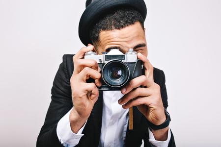 Closeup portrait stylish guy in hat, suit making photo on camera. Happy tourist, having fun, joy, isolated, smiling, expressing positivity, cheerful mood, photographer Imagens