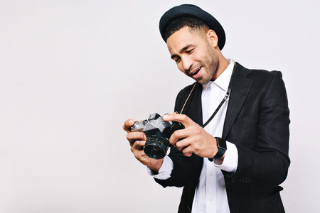Handsome joyful guy in suit, hat looking at camera in hands on white background. Travelling, tourist, having fun, retro style, true emotions.  Place for text