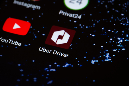 Kiev, Ukraine - October 3, 2017: the Uber Driver logo on the smartphone screen close-up. Editorial