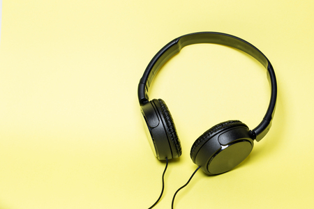 headphones black on a yellow background