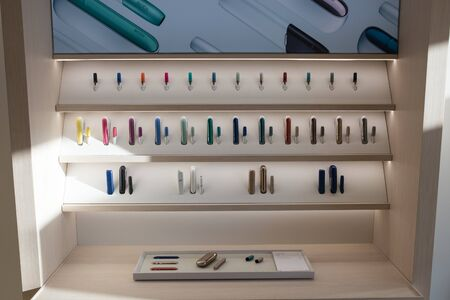 Kiev, Ukraine - January 17, 2019: New design IQOS. Showcase with a large multi-colored selection.