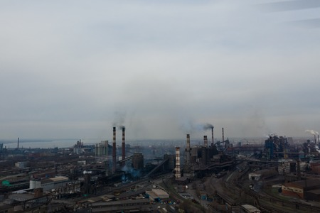 Polluting plant shot from above with a drone