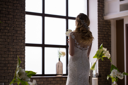 Bride stands with calla in her hands