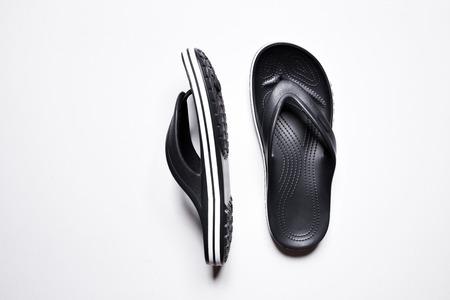 Flip Flops on a white isolated background. Men's black flip flops.