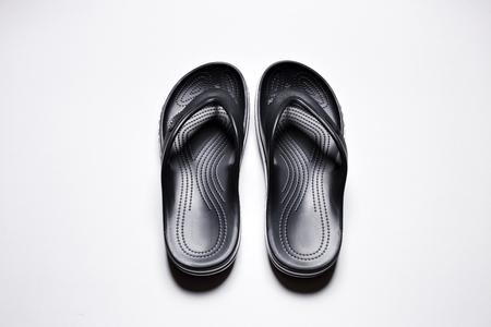 Flip Flops on a white isolated background. Mens black flip flops.