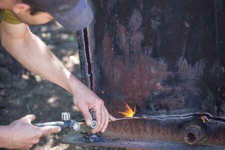 Worker cuts and brews black metal close-up shot